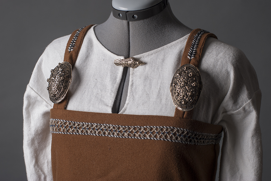 Viking dress with brooch close